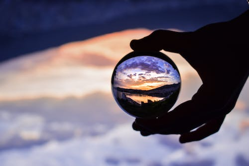 Free stock photo of beautiful view, crystal ball, hand, Lensball