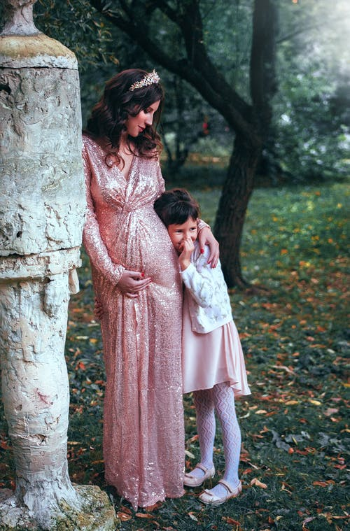Woman In  Pink Long-sleeved Dress With Child