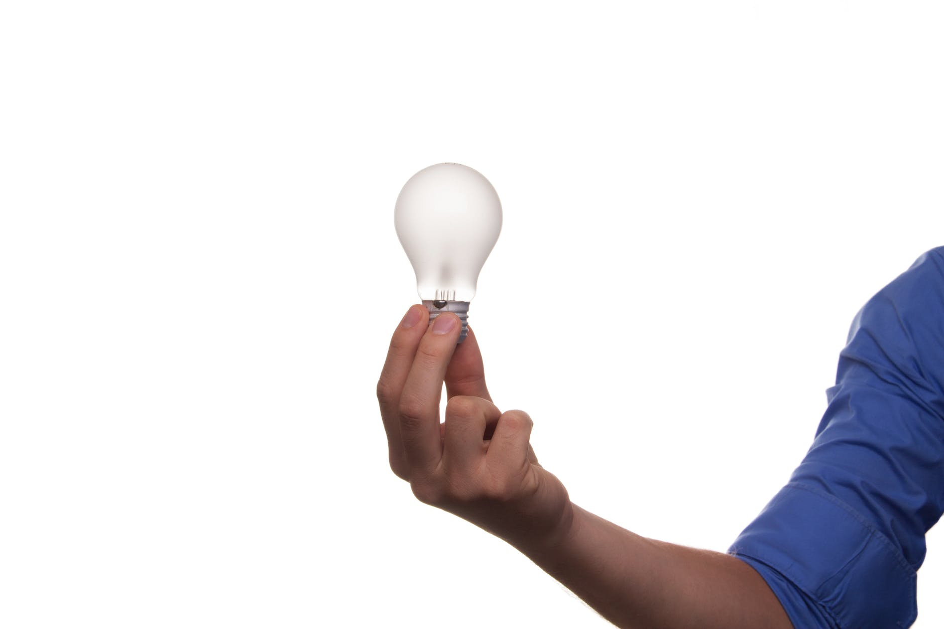 man holding a light bulb