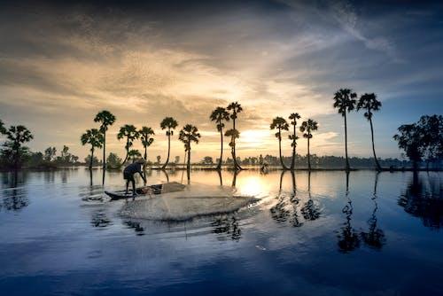 Δωρεάν στοκ φωτογραφιών με αλιεία, Ανατολή ηλίου, άνθρωπος, αντανάκλαση