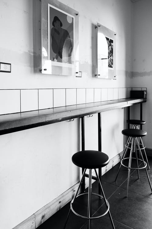 Grayscale Photography of Stools