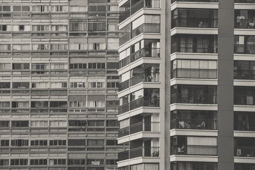 Gray-scale Photography of a Condominium Building