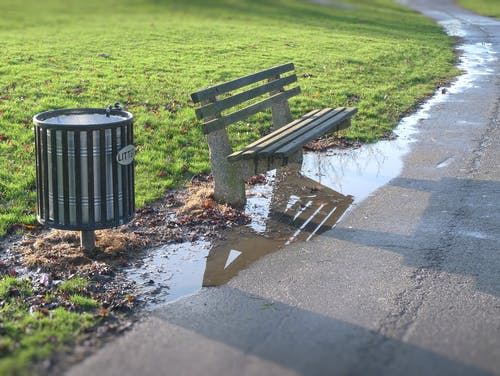 Free stock photo of bench, litter bin, park, puddle