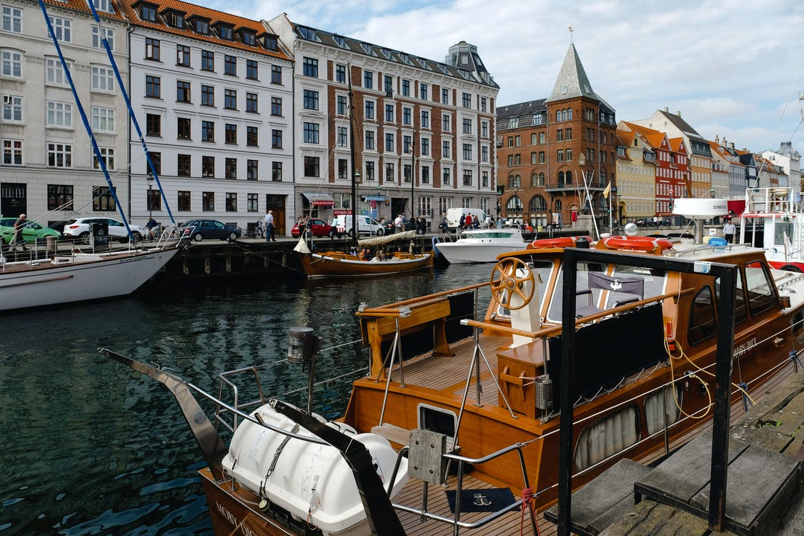 Best places to visit in Denmark. Here's a look at the floating boats on a canal in Copenhagen.