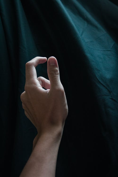 Person Showing Left Thumb