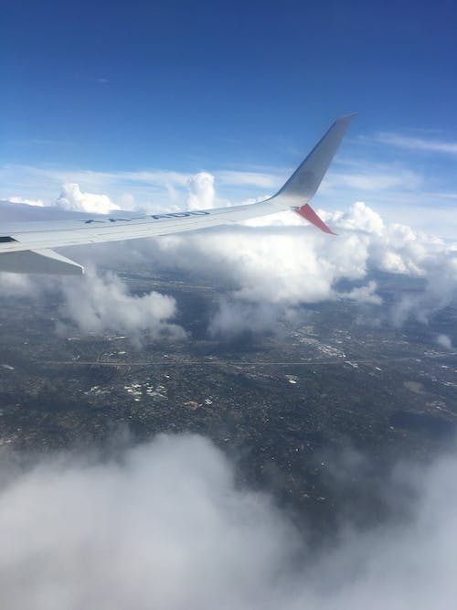 Free stock photo of aerial view, airplane window, airplane wing, clouds