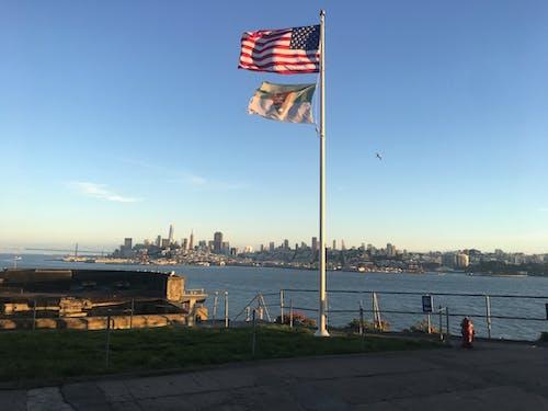 Photos gratuites de bord de mer, coucher de soleil, drapeaux, Drapeaux américains