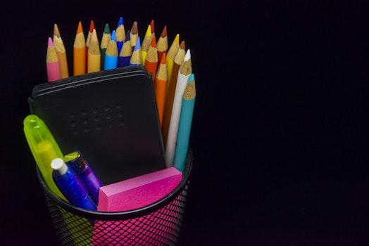 Multi Colored Pencils Against Black Background