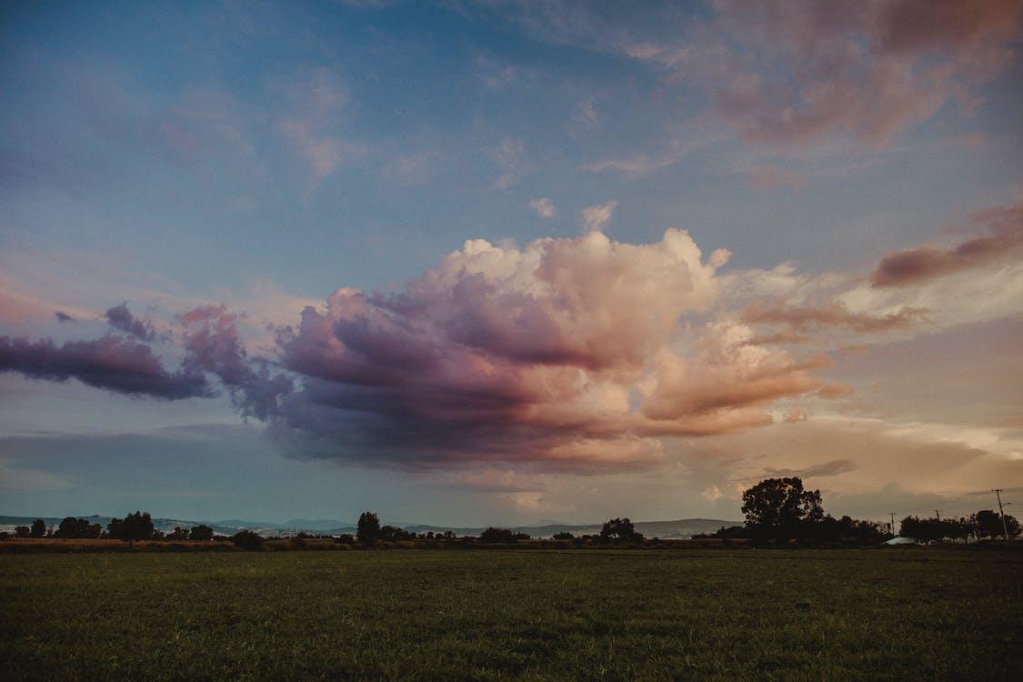 Dramatic Clouds Above A Farmland