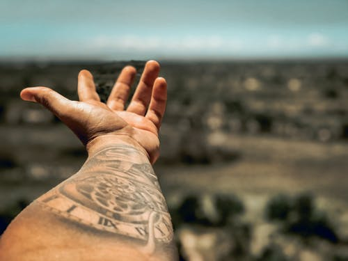 Selective Focus Photography of Person's Arm With Tattoo