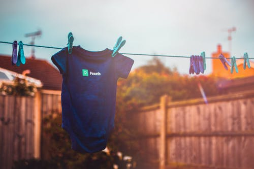 Kid's Blue Shirt hanging on the clothesline