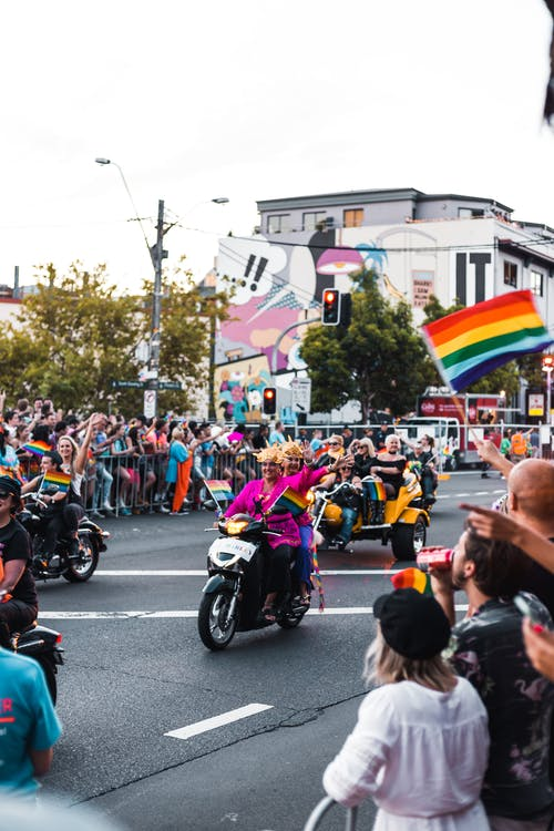 People on Motorcycles In A Parade