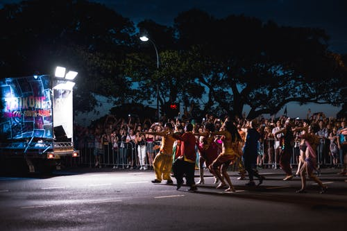 Group of People Dancing at the Street during Nighttime