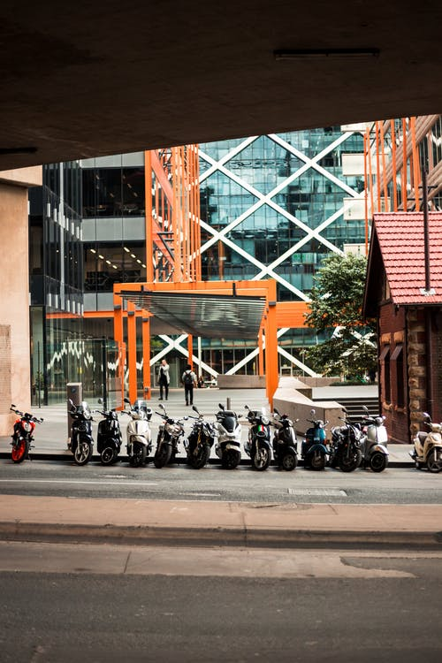 Motorcycles Parked Beside Building