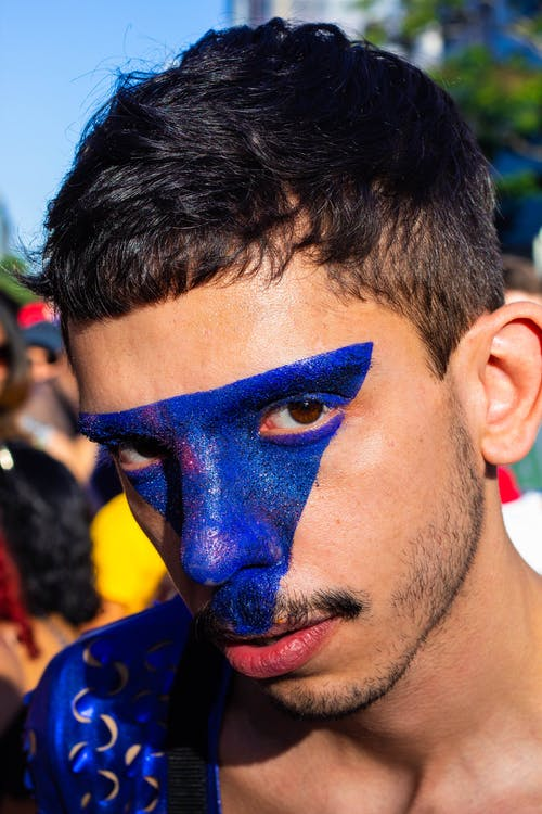 Close-Up Photo of Man With Blue Face Paint