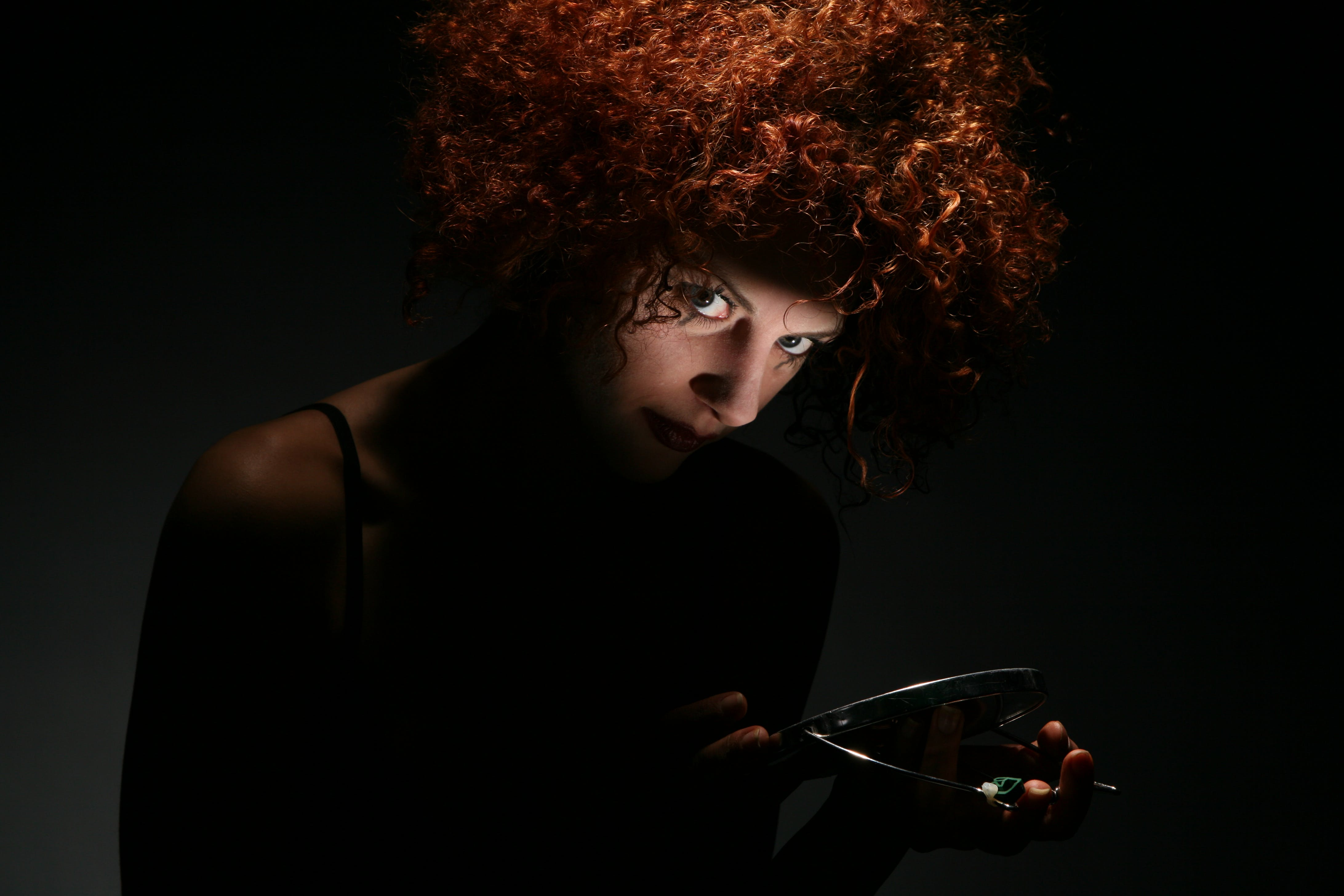 Red Haired Woman in Dark Room