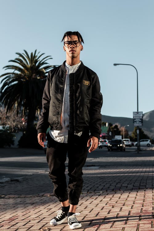 Man Wearing Black Zip-up Jacket And Black Pants