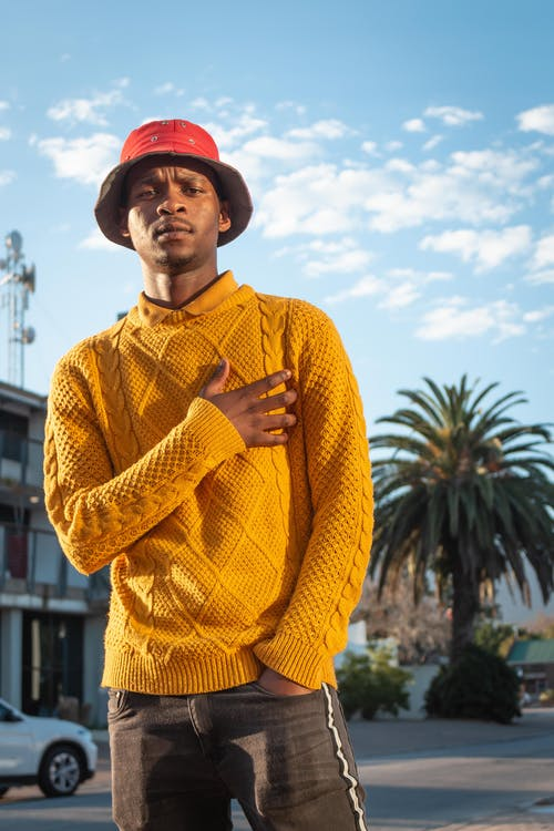 Photo of Man Wearing Yellow Sweater