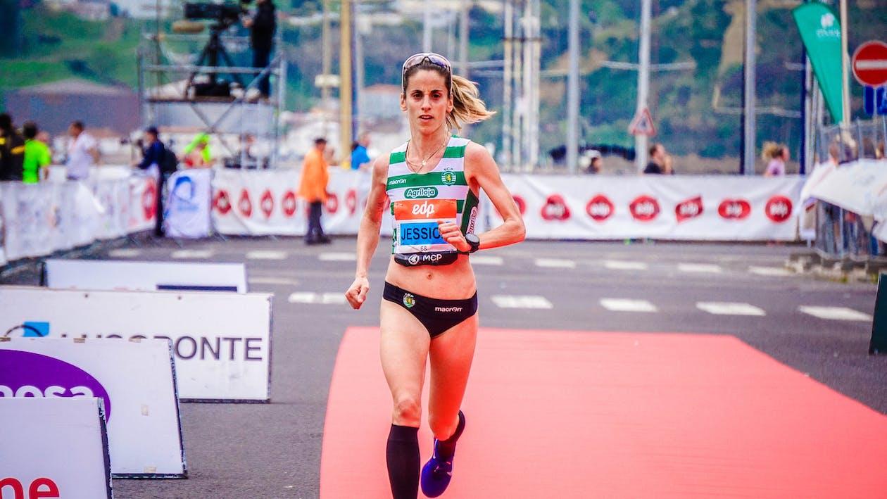 Woman Running in Orange Mat Outdoor