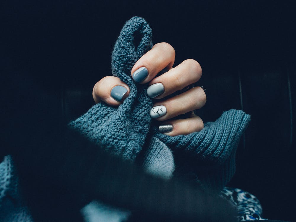 Blue Knitted Clothing And Nails
