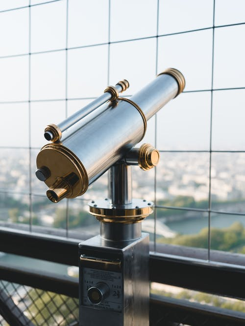 Vintage metal made telescope on Tower