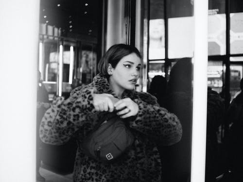 Monochrome Photo Of Woman Wearing Leopard Jacket