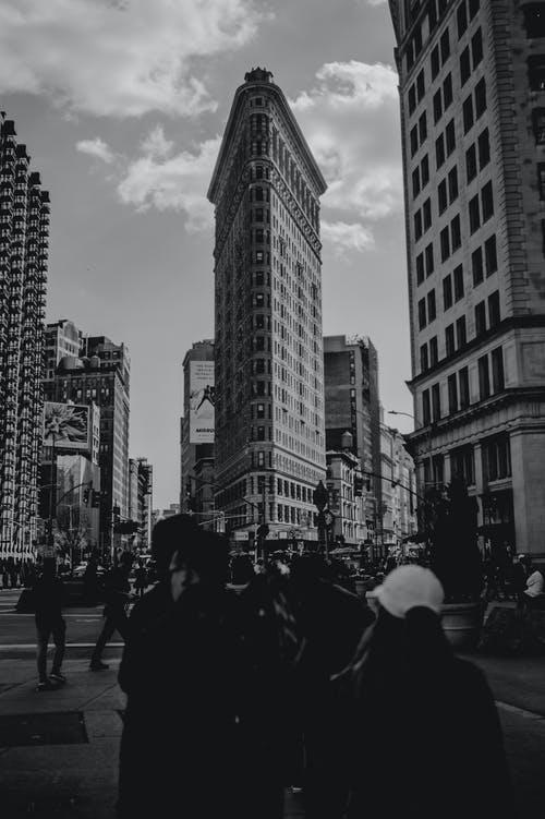 Grayscale Photography of People Walking Along Urban City Streets