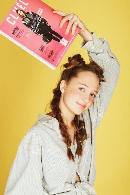 Photo of woman holding magazine