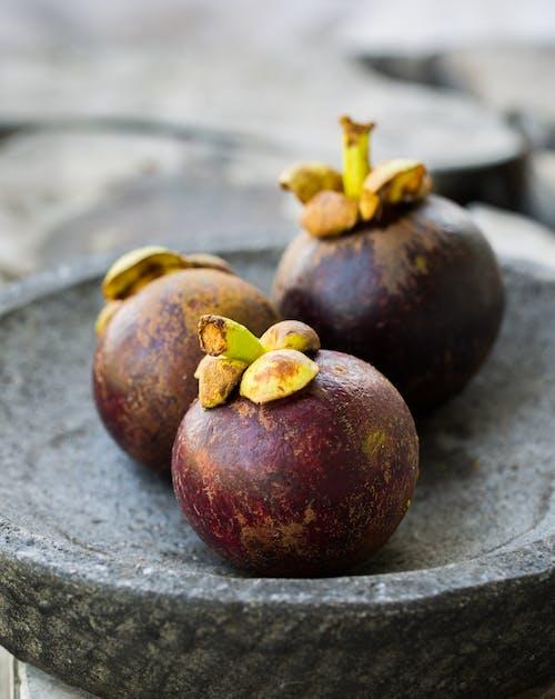 Close-Up Photo of Mangosteens