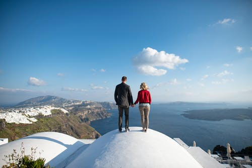 Photo Of Couple On Roof During Daytime