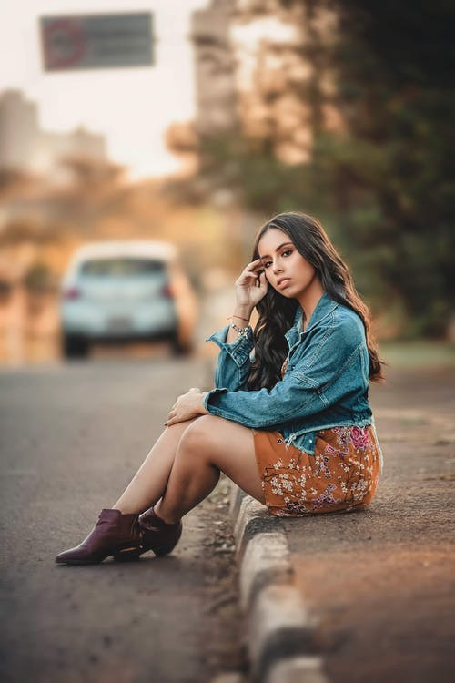 Photo of Woman Sitting On Pavement