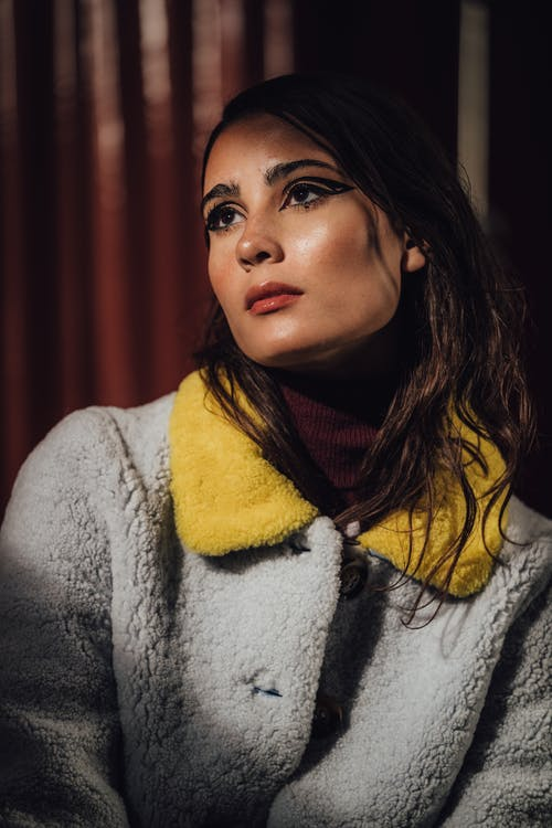 Woman in Gray and Yellow Fleece Coat