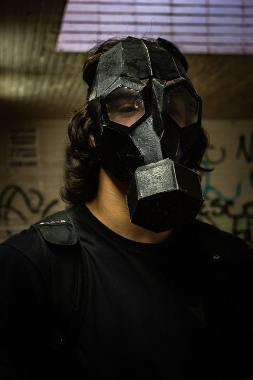 Portrait Photo of Man in Black Gas Mask