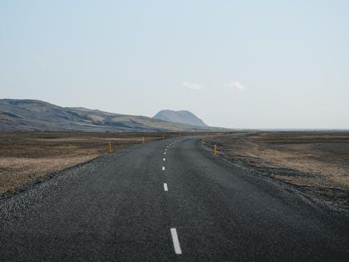 Foto profissional grátis de asfalto, deserto, desocupado, estrada