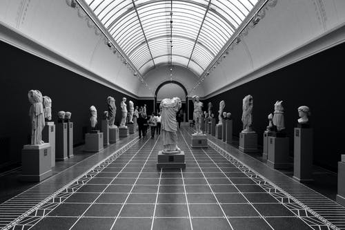 Grayscale Photo Of Statues
