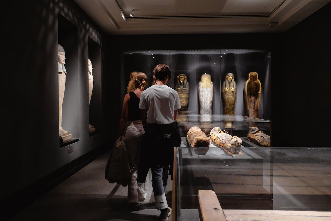Man and Woman Across Mummies
