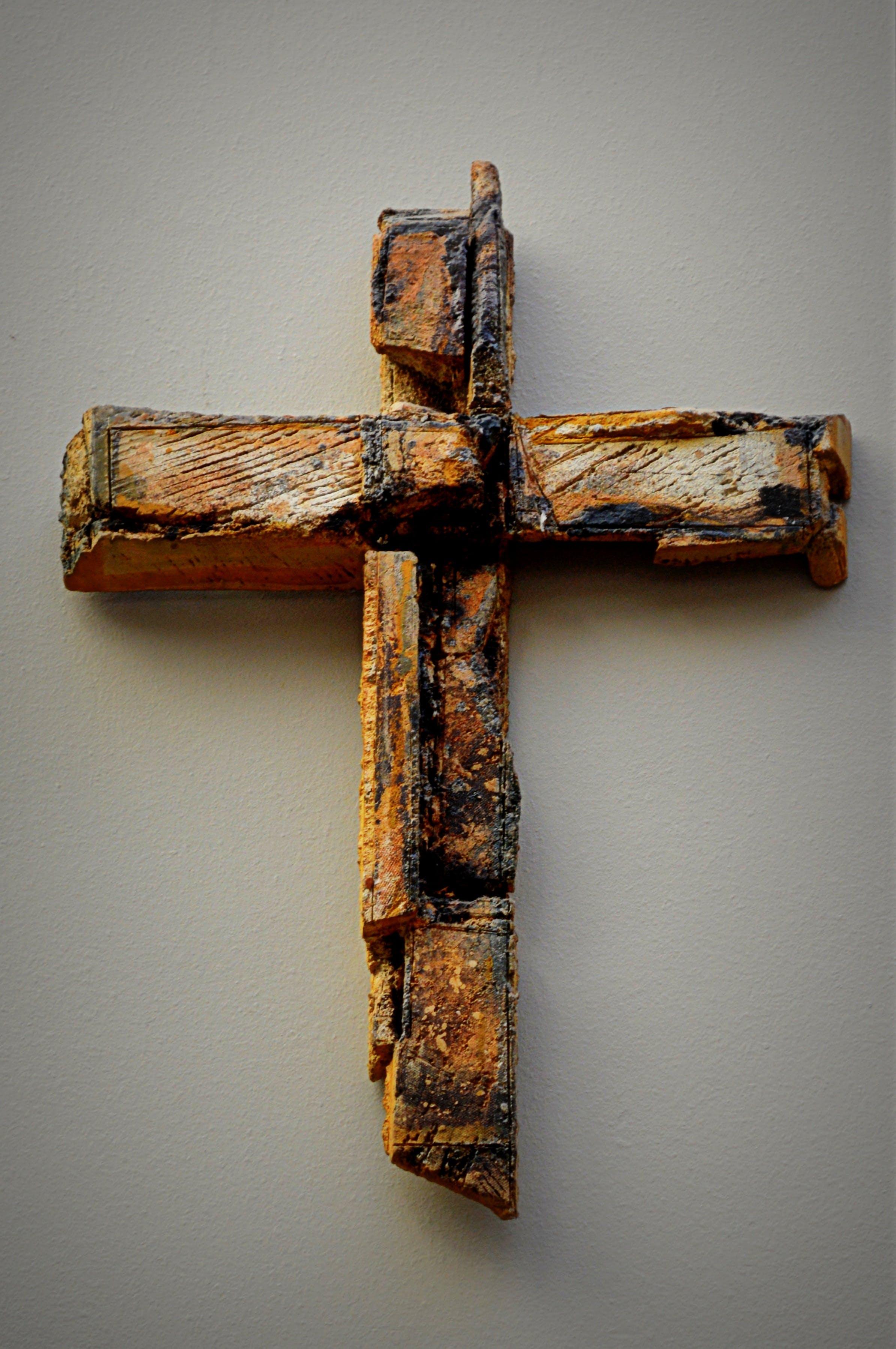 Rusty Metal on Cross Against Wall