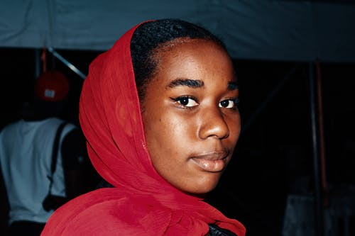Close-Up Photo of a Woman Wearing Red Scarf