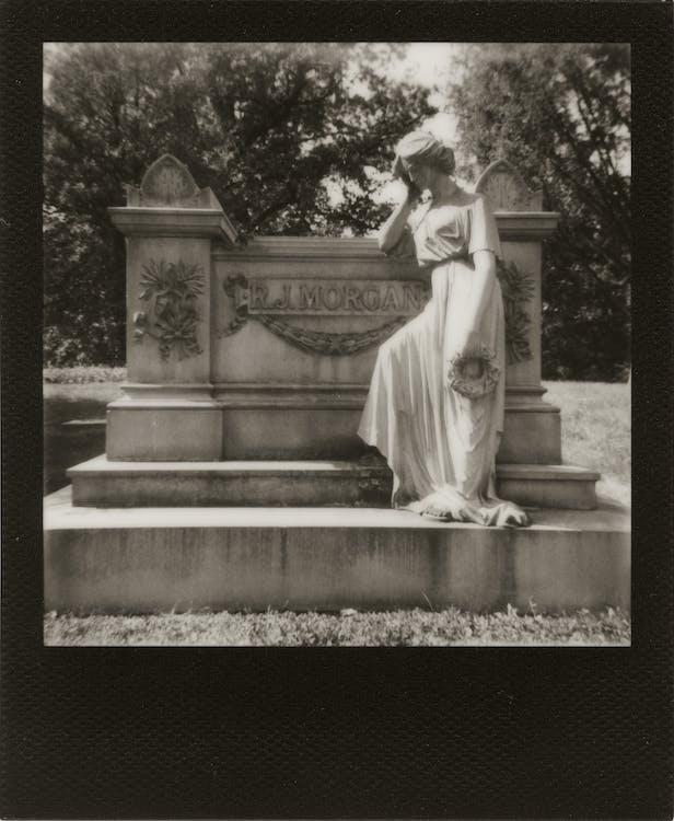 Woman Wearing Dress Statue