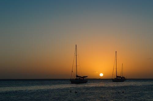 Ilmainen kuvapankkikuva tunnisteilla appelsiini, auringonlasku, meri, taivas