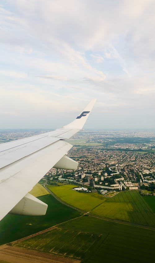 Free stock photo of airplane, airplane window, airplane wing, eiffel tower