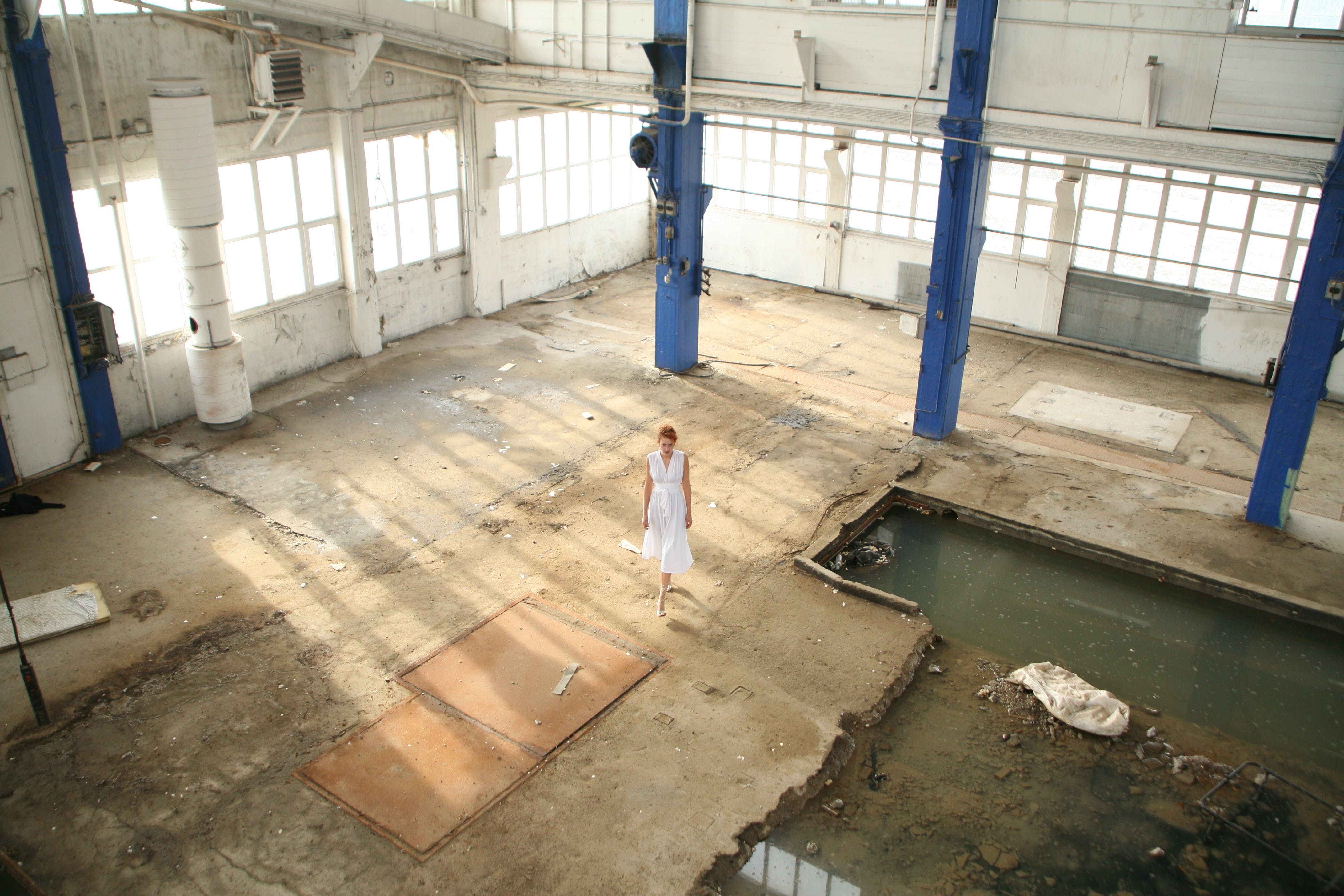 Woman Standing in White Building