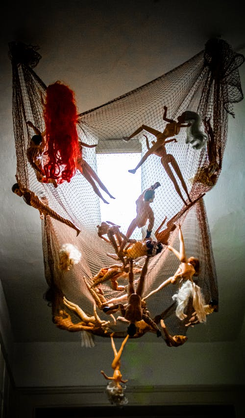 Dolls Hanging On A Net