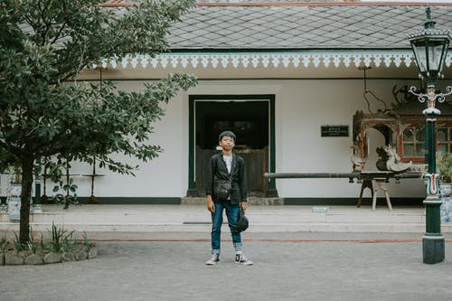 Person Standing In Front Of A Building