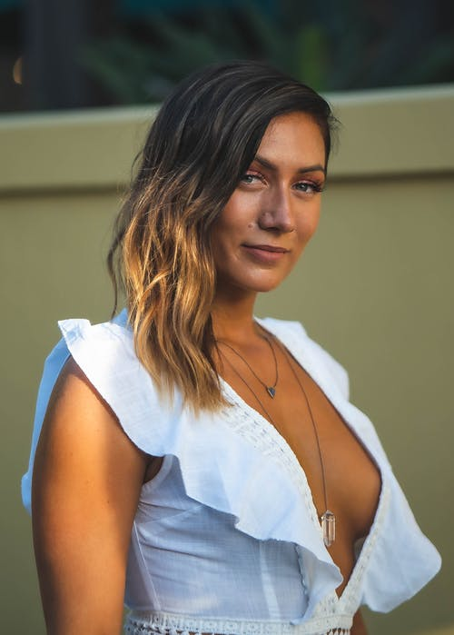 Woman Wearing White Deep V-neck Top