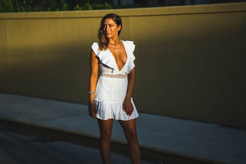 Woman In White Deep V-neck Mini Dress