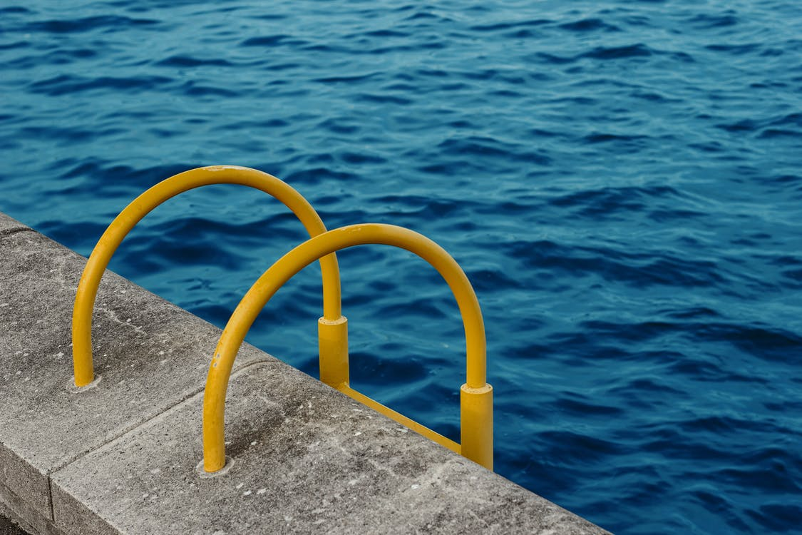 Yellow handrail for swimming pool
