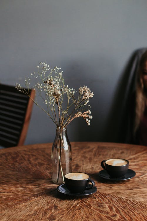 Photo Of Flower Vase Near Coffee Cups