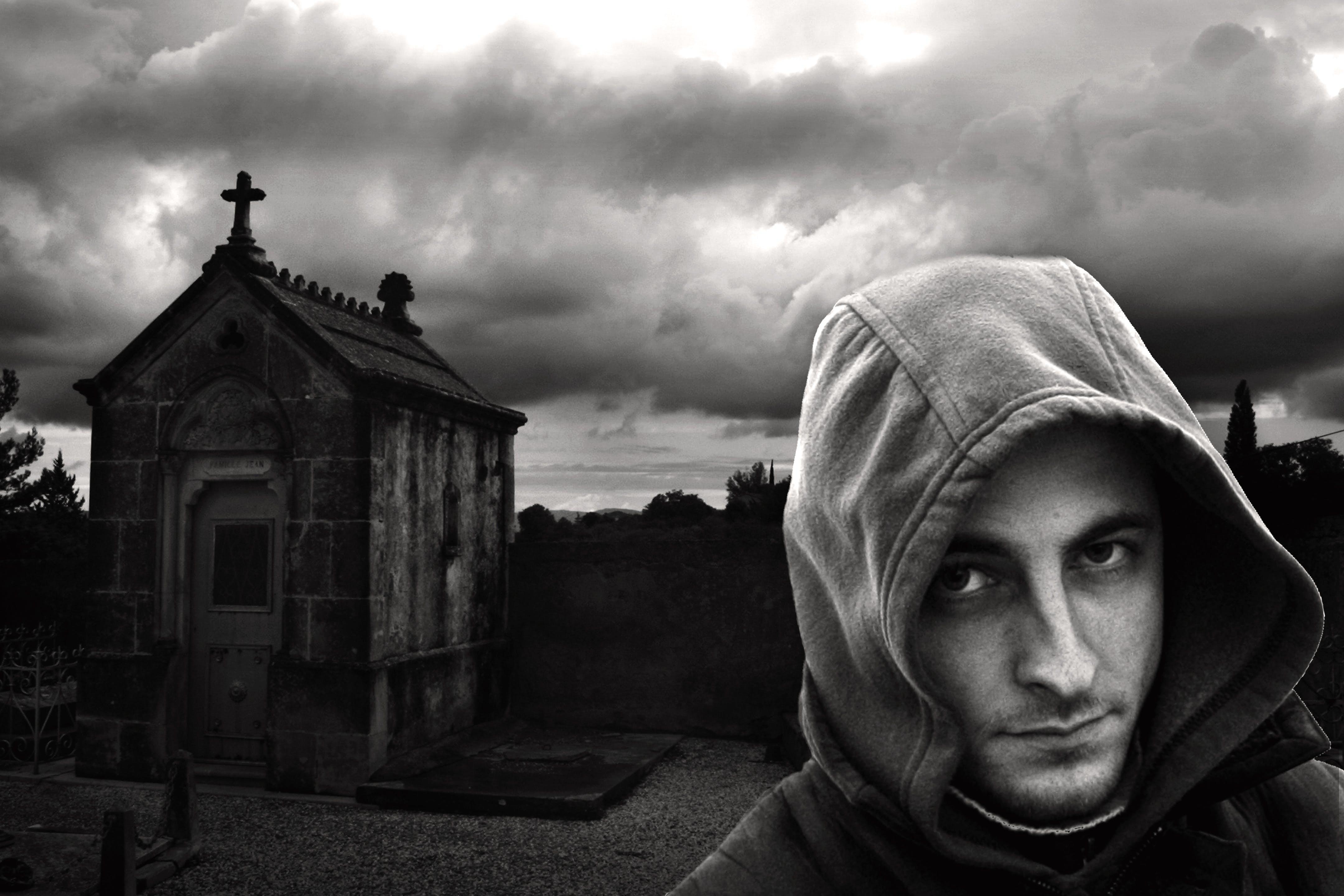 Man in Hoodie Near Church