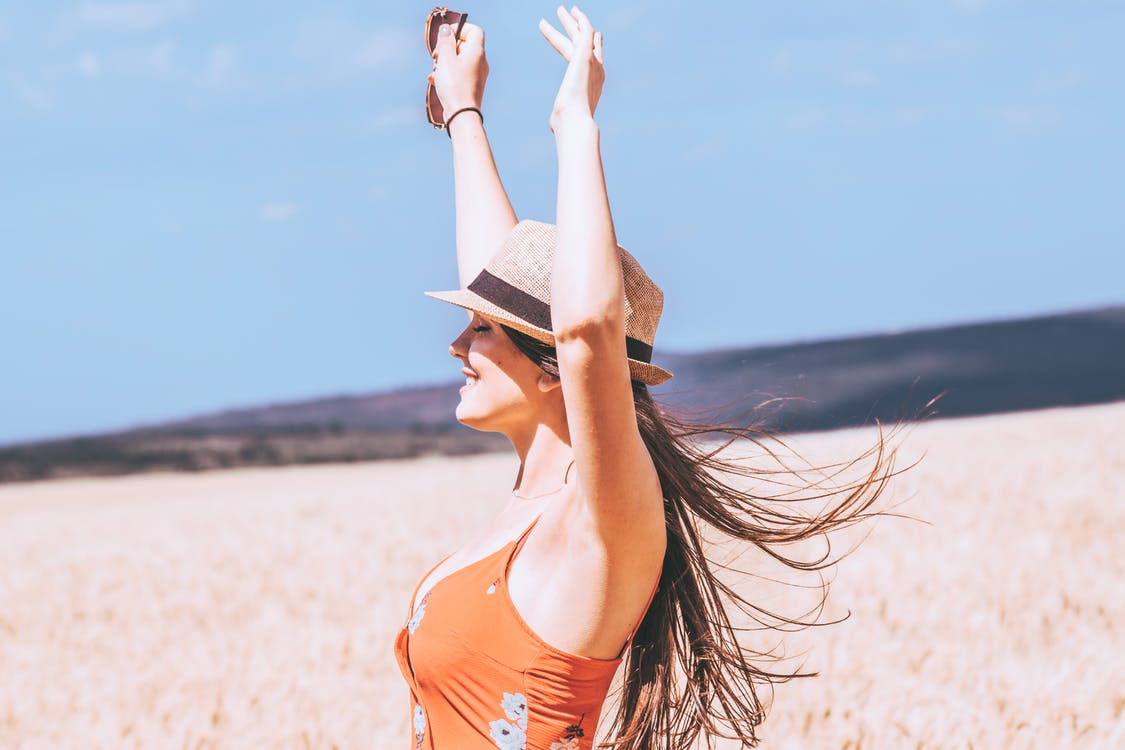Photo of Woman Raising Her Both Arms